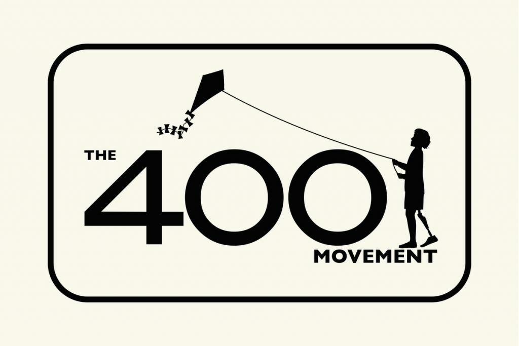"""A beige box with an outline in black. Inside the black outline are the words """"The 400 Movement"""". On top of the word movement is the image of little kid flying a kite."""